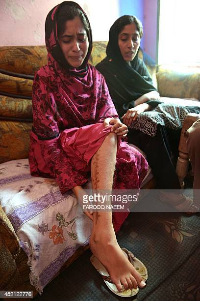 To go with AFP story PakistanwomenrightsprostitutionsocialUAEFEATURE by Khurram Shahzad In this photograph taken on May 8 sisters Zunera and Shaista...