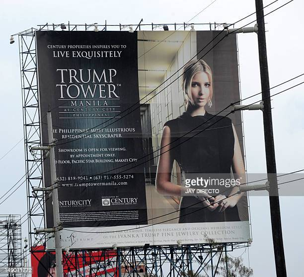 To go with AFP story PhilippineseconomypropertyFOCUS by Cecil Morella This photo taken on July 14 2012 shows a Trump Tower poster displayed on a...