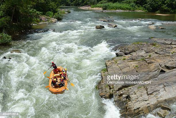 To go with AFP story 'Sri Lankafilmenvironmentelectricity'FEATURE by Amal Jayasinghe In this photograph taken on August 13 tourists take part in...