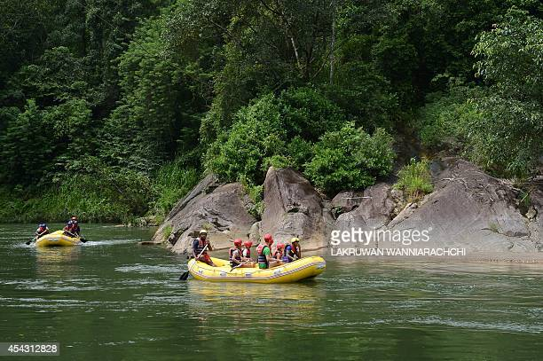To go with AFP story 'Sri Lanka-film-environment-electricity',FEATURE by Amal Jayasinghe In this photograph taken on August 13 tourists take part in...
