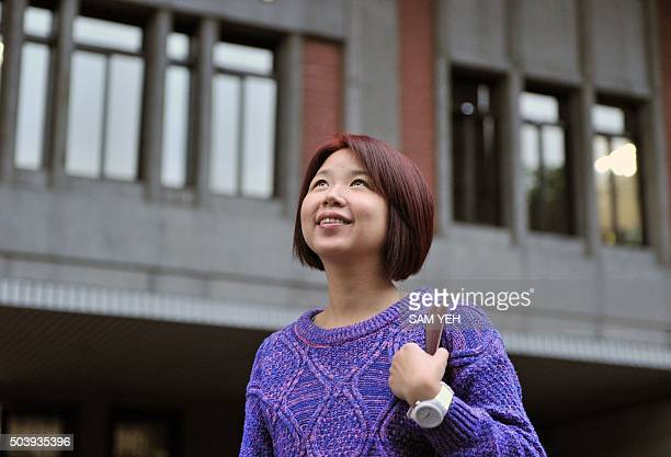 To go with AFP story' TaiwanCambodiapoliticsvotewomensocial' Interview by Amber Wang In this picture taken on December 29 Lin Lichan walks past the...