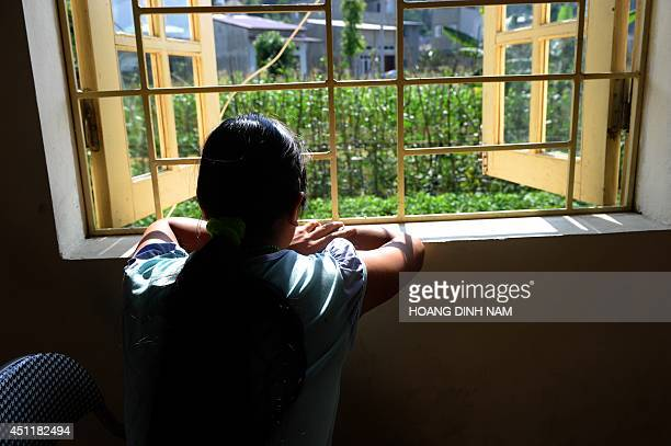To go with AFP story VietnamChinawomentraffickingsocialFEATURE by CAT This picture taken on May 9 2014 shows H'mong ethnic girl Kiab looking out from...