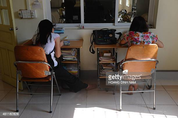 To go with AFP story VietnamChinawomentraffickingsocialFEATURE by CAT This picture taken on May 9 2014 shows H'mong ethnic teenager May Na and a...