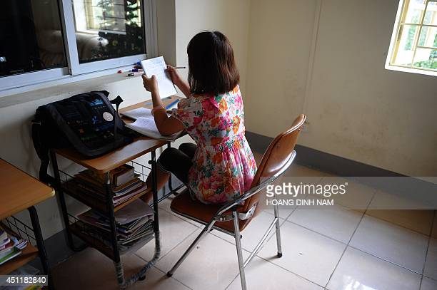 To go with AFP story VietnamChinawomentraffickingsocialFEATURE by CAT This picture taken on May 9 2014 shows a rescued girl doing her homework at a...