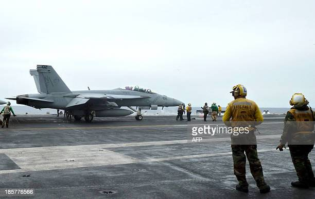 To go with 'AsiaUSmilitarydiplomacyINTERVIEW' by Martin Abbugao This photograph taken on October 24 2013 in the South China Sea shows a US fighter...