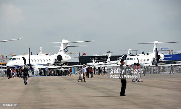 To go with AviationAsiaFOCUS by Martin Abbugao This photograph taken on February 14 2014 shows commercial planes on static dispaly at Singapore...