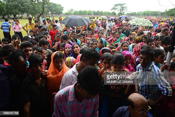 To go with Bangladesh-building-disaster-textile-compensation,FOCUS by Shafiq Alam In this picture taken on May 8, 2013 Bangladeshi garment workers,...