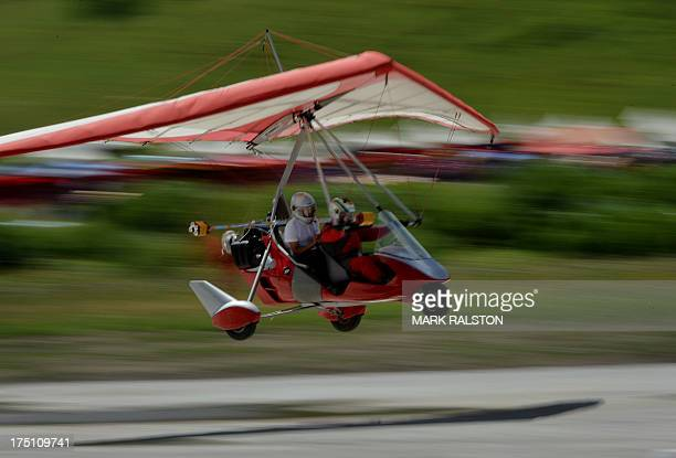 To go with ChinaaviationtechnologymilitaryrightsFEATURE by Tom HANCOCK This photo taken on July 28 2013 shows a microlight plane making a landing...