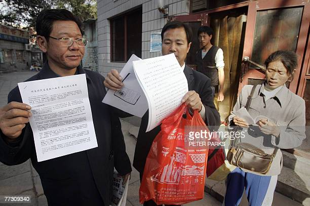 """To Go With """"China-politics-rights-letter"""" Petitioners show their papers in the deserted petitioner village in south Beijing, 12 October 2007, which..."""
