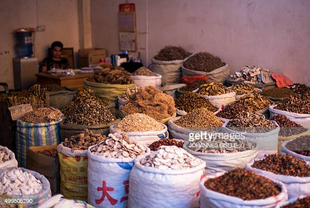 To go with ChinatraditionhealthawardNobelFOCUS by Rebecca Davis and Ludovic Ehret This picture taken on June 21 2015 shows various herbs and...