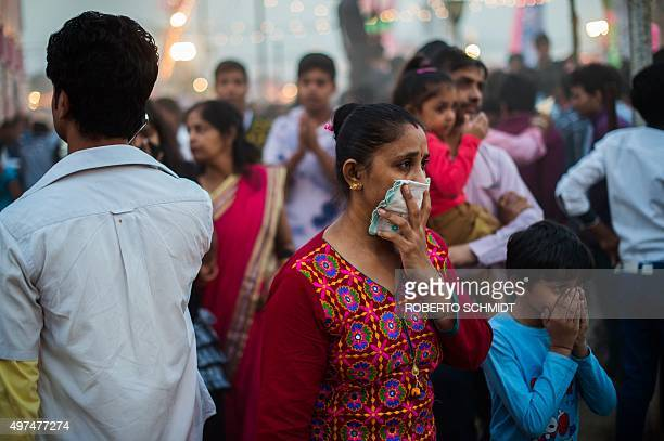 To go with ClimatewarmingUNCOP21IndiaFOCUS by Trudy Harris In this October 22 2015 photo an Indian woman and a child cover their faces in an effort...