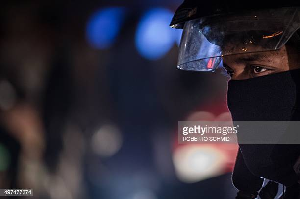 To go with ClimatewarmingUNCOP21IndiaFOCUS by Trudy Harris In this October 21 2015 photo a motorbike commuter wears a mask over his face as he waits...