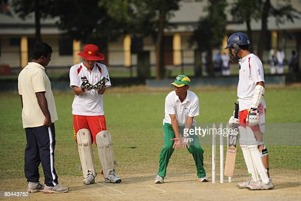 To go with CricketBANCHNAsiad by Shafiq Alam In this photograph taken on November 14 former Bangladeshi international batsman Aminul Islam teaches...