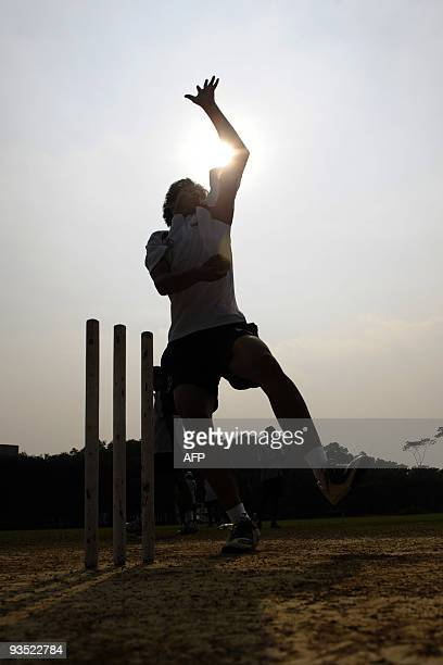 To go with Cricket-BAN-CHN-Asiad by Shafiq Alam In this photograph taken on November 14 a young Chinese cricketer bowls during training at...