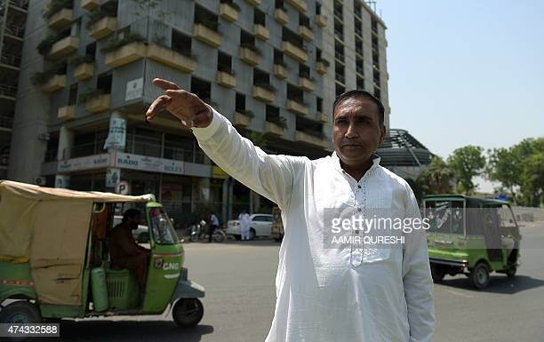 To go with 'CricketPakZimSriAttacksDriver' by Shahid HASHMI In this photograph taken on May 21 Pakistani bus driver Meher Mohammad Khalil who drove...