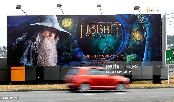 "To go with ""Entertainment-NZealand-film-tourism-Hobbit,ADVANCER"" by Neil Sands This picture taken on November 24th, 2012 shows a car driving past a..."