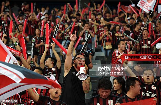 To go with 'Fbl Asia CHN fans' Focus In this picture taken on July 25 Liu Shu a supporter of AC Milan cheers for his team ahead of the International...