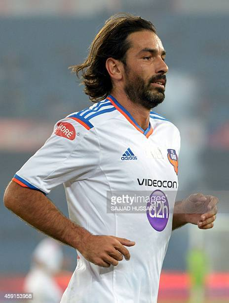 To go with FBLINDISL FOCUS by Trudy Harris In this photograph taken on November 13 FC Goa football player Robert Pires runs during the India Super...