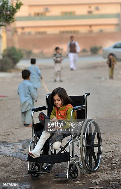 To go with feature 'Pakistanunrestamputees' by Khurram Shahzad Seven yearold disabled Pakistan girl Laiba adjusts her artificial foot as she sits in...