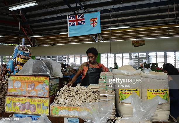 To go with FijivoteSCENE by Neil Sands A woman sells the ingredients for kava a Western Pacific drink with sedative and anesthetic properties in the...