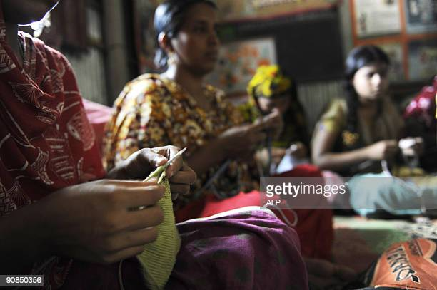 To go with FinanceeconomyBangladeshtradetextile by Julie Clothier In a picture taken on July 27 Bangladeshi women work in a garment factory in...
