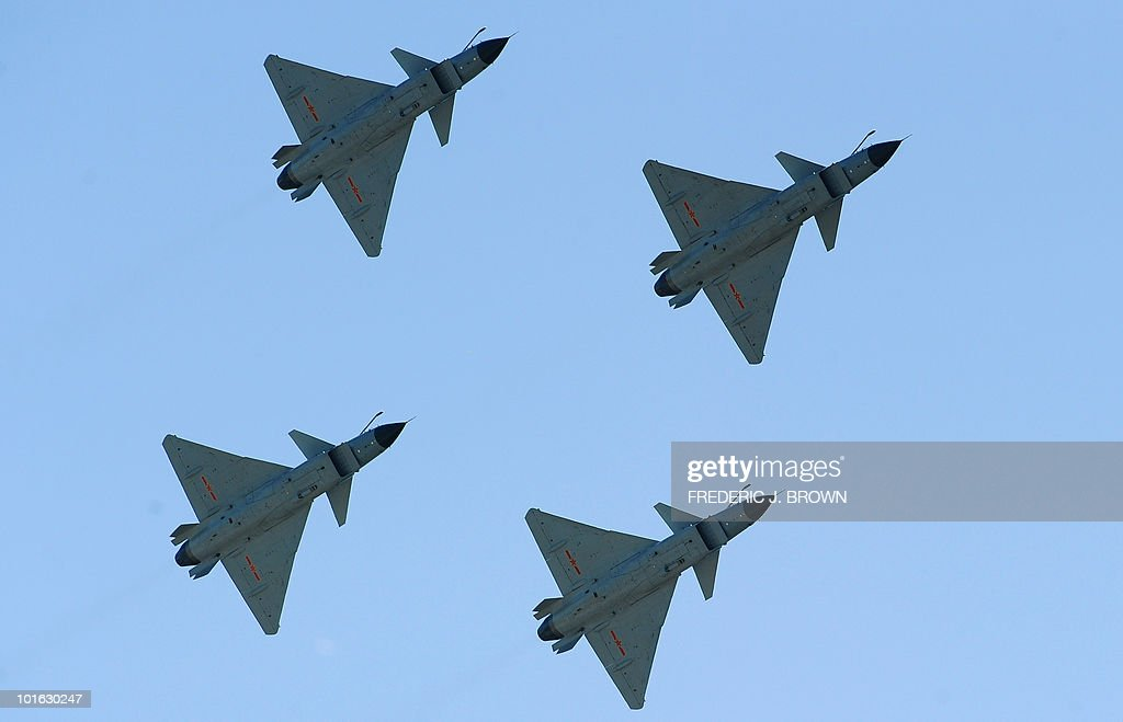 To go with focus story China-military-media by Francois Bougon (FILES) In a file picture take on April 13, 2010 Chinese J-10 fighter jets fly during a display to which journalists were invited at the Yangcun Air Force base of the People's Liberation Army Air Force in Tianjin, southeast of Beijing. In his celebrated treatise 'The Art of War', Chinese military strategist Sun Tzu warned against transparency. Today, China's army is ignoring his advice and has launched a media charm offensive in the hope of calming fears over its growing power. AFP PHOTO/FILES/Frederic J. BROWN