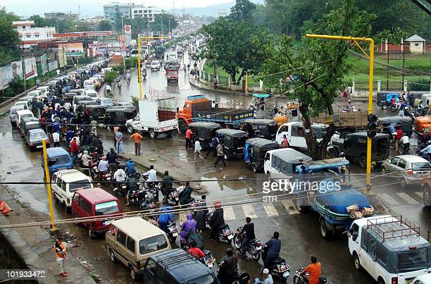 To go with focus story Indiaunrestnortheastblockade by Raymond Kharmujai Vehicles form a queue for oil near a petrol pump in Manipur state capital...