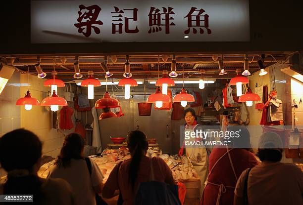 To go with Hong KonglifestylefoodenvironmentFEATURE by Dennis Chong This picture taken on June 25 2015 shows customers outside a seafood stall in the...