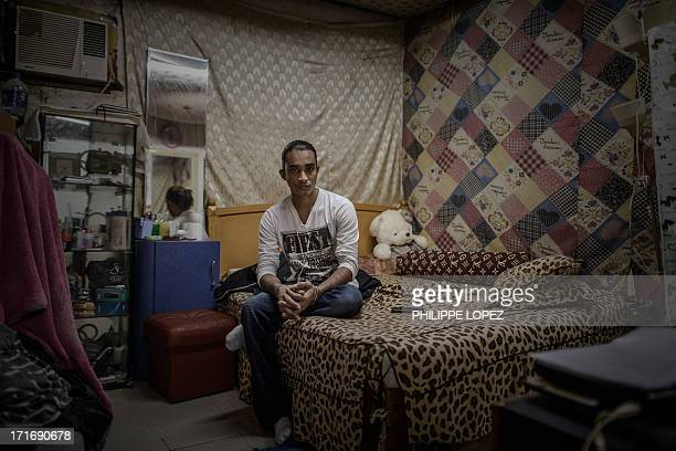 To go with HongKongAsiaimmigrationrefugeeFEATURE This picture taken on June 11 2013 shows Bangladeshi refugee Nazmul Huda in his room at a compound...