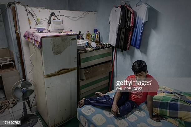 To go with HongKongAsiaimmigrationrefugeeFEATURE This picture taken on June 11 2013 shows a refugee from Bangladesh in his room at a compound where...
