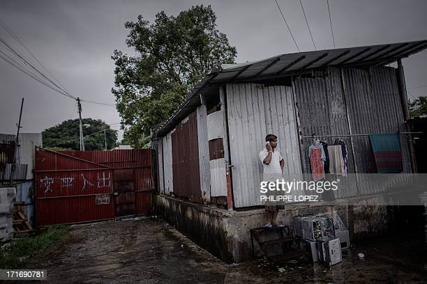 To go with HongKongAsiaimmigrationrefugeeFEATURE This picture taken on June 11 2013 shows a refugee from Bangladesh using a mobile phone at a...