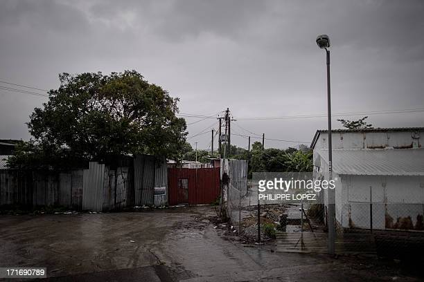 To go with HongKongAsiaimmigrationrefugeeFEATURE This picture taken on June 11 2013 shows a compound made up of mostly illegal structures where...