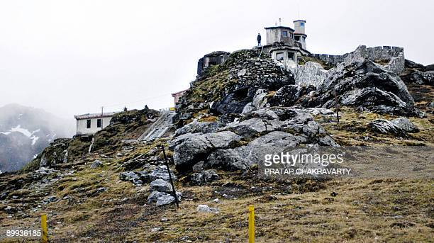 To go with IndiaChinamilitarydiplomacyFOCUS by Pratap Chakravarty In this file photo taken on May 30 a solitary Chinese soldier stands atop a bunker...