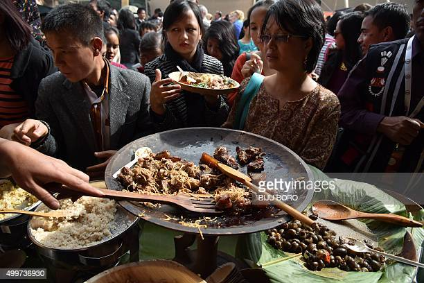 To go with 'IndiaFoodOrganicLifestyle' FEATURE by Etienne Fontaine In this photograph taken on November 7 visitors sample a variety of dishes at The...