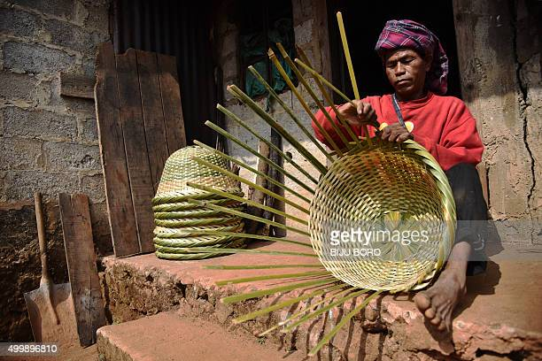 To go with 'IndiaFoodOrganicLifestyle' FEATURE by Etienne Fontaine In this photograph taken on November 6 an Indian Khasi tribe villager weaves a...