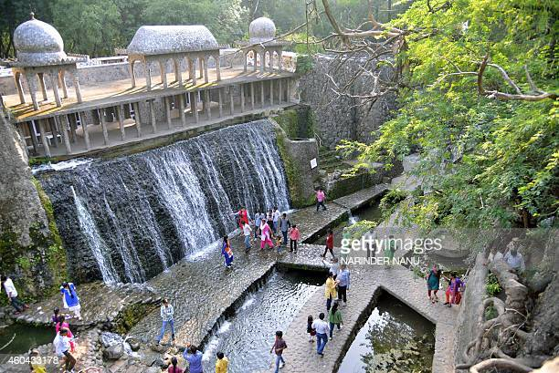 To go with India-garden-environment-tourism,FEATURE by Abhaya SRIVASTAVA This photo taken on October 31, 2014 shows Indian visitors in the Rock...