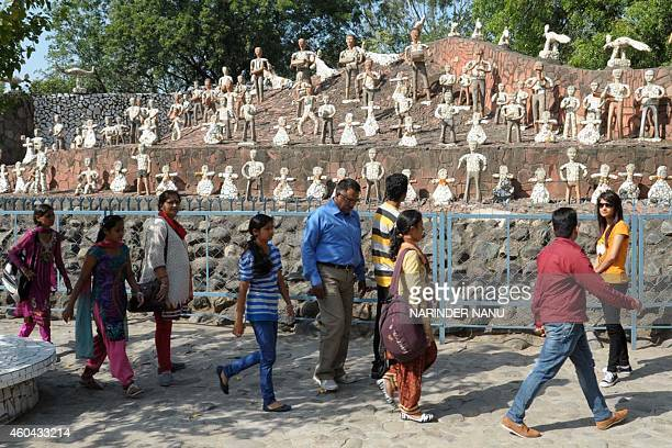 To go with IndiagardenenvironmenttourismFEATURE by Abhaya SRIVASTAVA This photo taken on October 31 2014 shows Indian visitors in the Rock Garden...