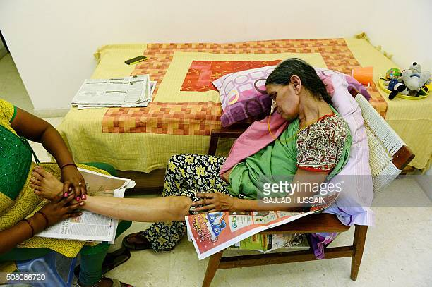 To go with IndiahealthnegligencemedicalFEATURE by JALEES This photograph taken on September 13 2015 shows 62yearold Indian woman Suresh Rani given an...