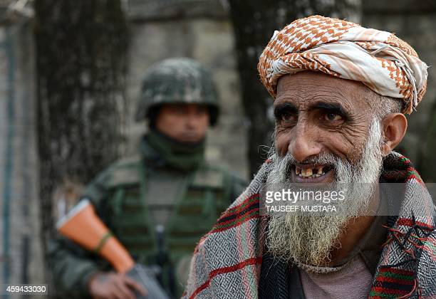 To go with IndiaPakistanKashmirelectionFOCUS by Parvaiz Bukhari In this photograph taken on November 20 an ethnic Kashmiri Gujjar listens to a...