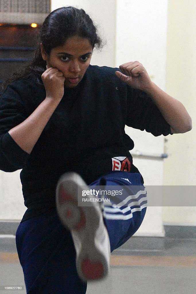To go with 'India-rape-politics-women-selfdefence,FOCUS' by Abhaya Srivastava This picture taken on January 2, 2013 shows an Indian woman practicing kicks during a self-defence class in New Delhi. After nearly three weeks of lurid reporting on a horrifying gang-rape in New Delhi, women in the Indian capital say they are more anxious than ever, leading to a surge in interest in self-defence classes.