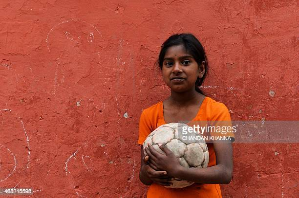 To go with IndiasocialhealthleprosyFEATURE by Abhaya SRIVASTAVA In this photograph taken on March 11 Maya whose parents are cured patients of leprosy...