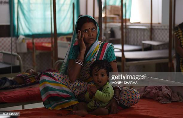 To go with 'IndiaSocialPovertyMalnutrition' FEATURE by Agnes BUN In this photograph taken on October 19 seven month old malnourished Indian child...