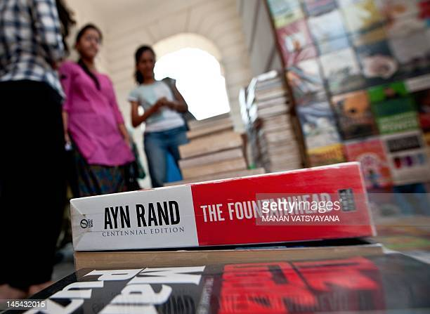 To go with IndiasocietybookspoliticsFEATURE by Ammu Kannampilly In this picture taken on May 24 young Indian women search for books where Ayn Rand's...