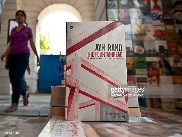 To go with IndiasocietybookspoliticsFEATURE by Ammu Kannampilly In this picture taken on May 24 a young Indian woman walks past a display of Ayn...