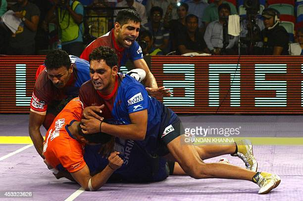 To go with IndiaSportLifestyleKabaddi by Abhaya Srivastava In this photograph taken on Augusy 6 players of Dabang Delhi hold on to a raider of Bengal...