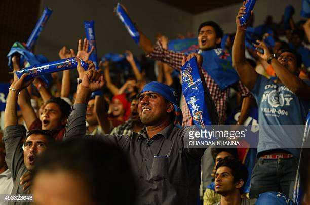 To go with IndiaSportLifestyleKabaddi by Abhaya Srivastava In this photograph taken on August 6 spectators cheer at the match between Dabang Delhi...