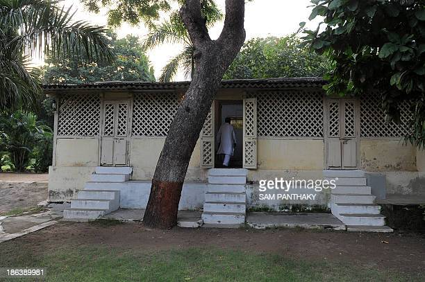 To go with IndiatourismGandhiFEATURE by Rajesh Joshi In this photograph taken on October 11 ashram coordinator Rameshbhai Trivedi walks into the...
