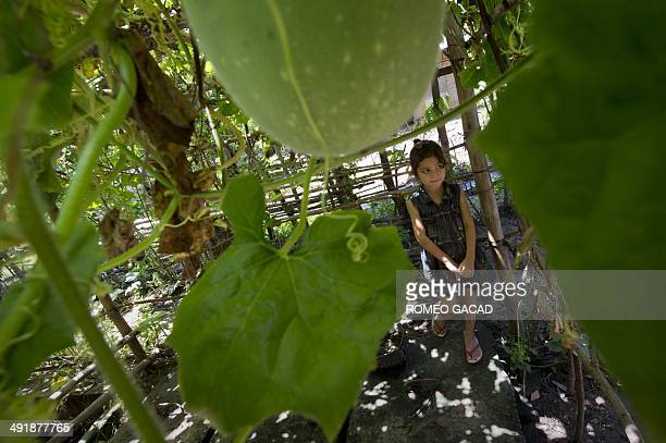 To go with Indonesia-environment-energy FEATURE by Angela Dewan In this photograph taken on March 20 seven year old Sumbanese girl, Gerarda Malarani...