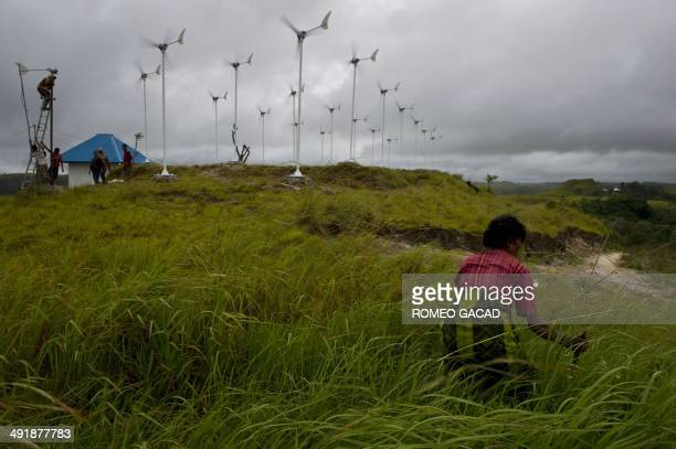 To go with Indonesiaenvironmentenergy FEATURE by Angela Dewan In this photograph taken on March 19 2014 a Sumbanese woman gathers grass to feed farm...
