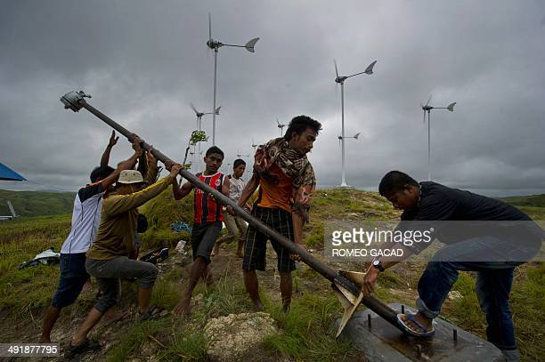 To go with Indonesiaenvironmentenergy FEATURE by Angela Dewan In this photograph taken on March 19 Sumbanese residents erect additional windmill on a...